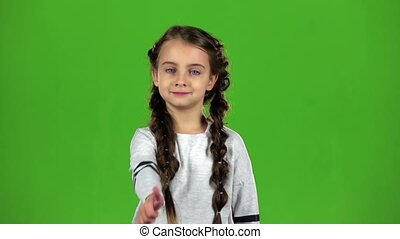 Child girl shows thumbs up. Green screen. Slow motion -...