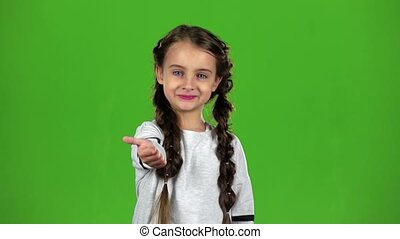 Baby girl shows thumbs up. Green screen. Slow motion - Baby...