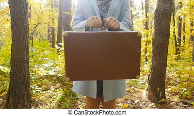 Young woman with a suitcase in an autumn park - Happy Young...