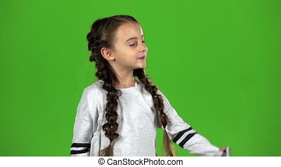 Baby does selfie. Green screen. Slow motion - Baby makes a...