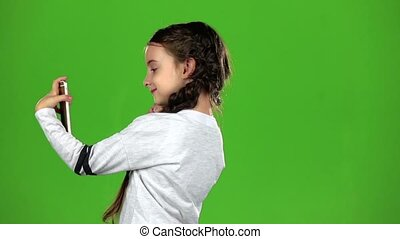 Child does selfie. Green screen. Slow motion - Child makes a...