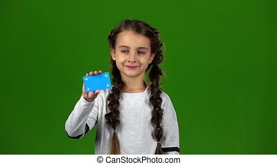 Baby shows an empty card. Green screen. Slow motion - Baby...