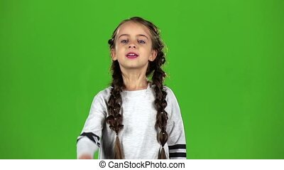 Child is unhappy. Green screen. Slow motion - Child is in a...