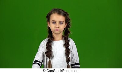Child shows an empty card. Green screen. Slow motion - Child...