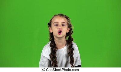 Child speaks into the loudspeaker. Green screen. Slow motion...