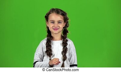 Child speaks into the loudspeaker. Green screen. Slow motion...