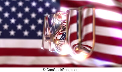 Rotating glass USA caption against waving American flag....
