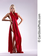Fashion model - Beautiful woman naked with red material...