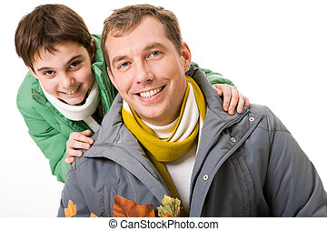 Glad guys - Image of happy man and his son smiling at camera