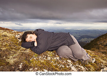 Snooze on top of the world - A woman has a little shuteye on...