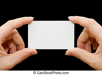 Paper card in woman hand isolated on black background