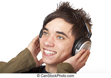 Male Teenager listening to music via headphone and sings