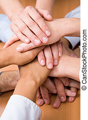 Pile of hands - Image of business partners hands on top of...