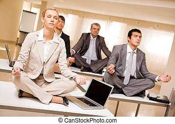 Meditating business partners - Portrait of meditating...