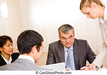 Business planning - Image of business people communicating...
