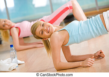 Activity - Image of sporty girl doing physical exercise with...