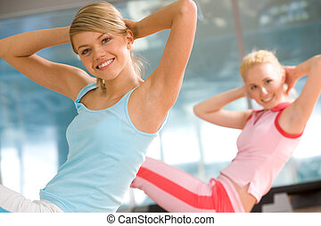 Doing exercises - Photo of cheerful girl doing exercise in...