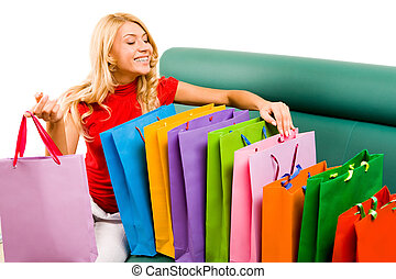 Looking through shoppingbags - Portrait of smiling blonde...