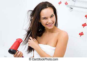 Drying hair - Photo of joyful female drying her hair after...