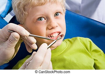Dental treatment - Photo of little boy before mouth checkup...