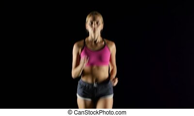 Woman sports running on the black screen. Close up - Woman...