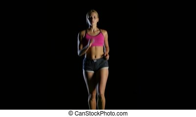Woman young running on the black background - Woman young in...