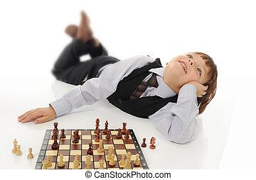 schoolboy playing chess. Isolated on white background