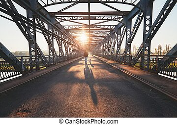 Morning walk across the river. Silhouettes and shadows of...