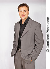 Attractive young man in suit - Portrait of attractive...