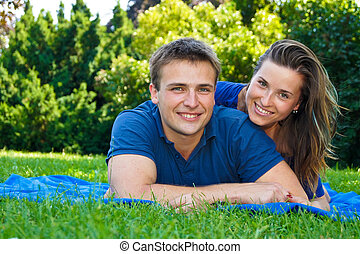 Happy couple in nature - Happy young couple have nice day in...