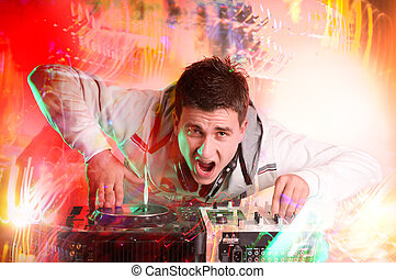 Disc Jockey - Disc jockey spinning and mixing records at...