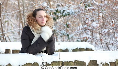 winter time - woman in fur coar waiting on the bridge in...