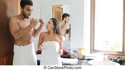 Couple Brushing Teeth In Bathroom, Dancing Cheerful Man And...