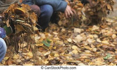 Unknown little children in autumnal park - Autumn time....