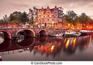 Night city view of Amsterdam canal and bridge - Amsterdam...