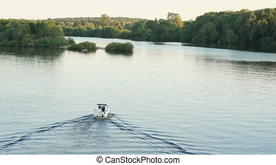 Small lonely motor boat along river - Picturesque panorama -...