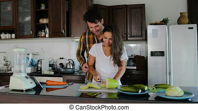 Man Embrace Woman Cutting Vegetables To Prepare Healthy...