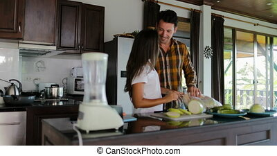 Man Embrace Woman Happy Smiling Couple In Kitchen Cooking...