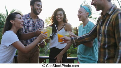 People Group Cheers Glasses Talking Outdoors On Summer...