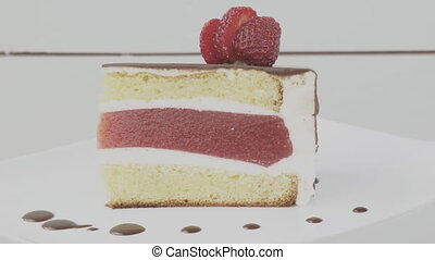 cake with strawberry jelly on white table