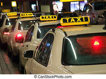 Taxis waiting at the airport - Taxis waiting in line at the...