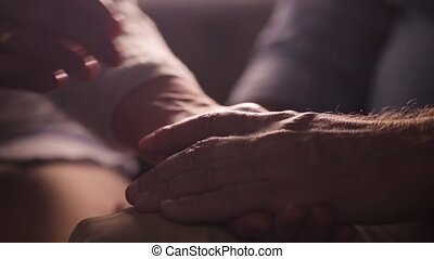 senior couple holding hands - relationships, old age and...