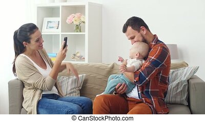happy family with baby photographing at home - family,...