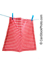 Hanging laundry - Hanging checkered cloth as laundry at the...