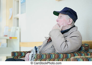Elderly man deep in thought