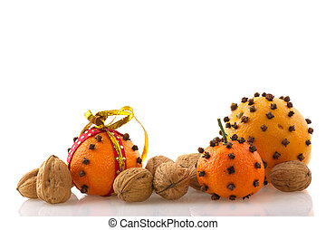 Orange with cloves - orange with cloves and walnuts isolated...
