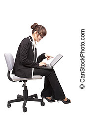 Business woman using laptop on the chair