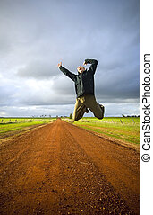 Jumping Man - Adult male leaps high into the air with much...