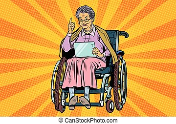 elderly woman disabled person in a wheelchair, gadget...