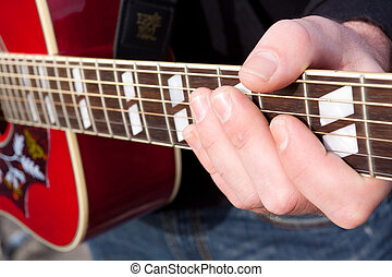 Guitar Player Chord - A guitar player's hand photographed...